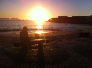 estátua drummond copacabana nascer do sol